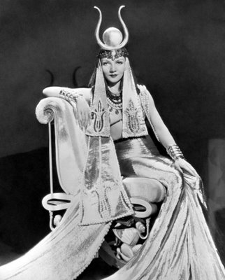 Claudette Colbert as Cleopatra on throne