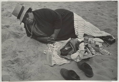 Beach Scene: Woman Wearing Striped Hat and Dark Jacket, Coney Island, New York, 1960s
