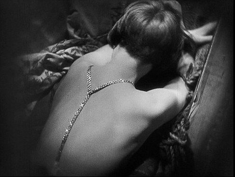 Pandora's Box (1929) was adapted from 2 erotic plays written in the 1890s by Frank Wedekind, but updated to then-modern times. As many young women cut their cumbersome long hair, Brooks as the Lulu character sports her own iconic, modern bob and wears clothes un-constrictive enough that she can do light gymnastics (like swing from a strongman's biceps), hinting at the newly acceptable athleticism for women (see my post on Athletic Aesthetics). The erotic zones had shifted and multiplied since Theda Bara's time, moving from the ankle to the shoulders, back, legs, and breasts which were often displayed braless.