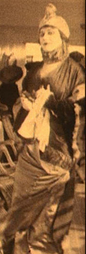 Theda Bara in hobble skirt and turban ensemble