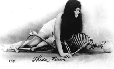 Theda Bara in nightgown with skeleton